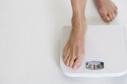 Лишний вес как причина потливости